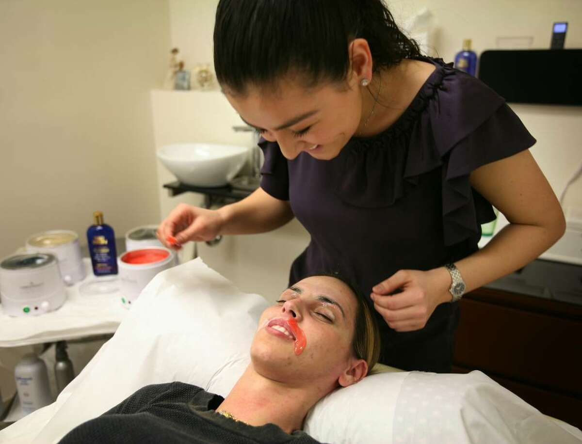 Veridiana Takemori waxes client Diorgia Lima at The Waxing Spot at 420 Post Road West in Westport.