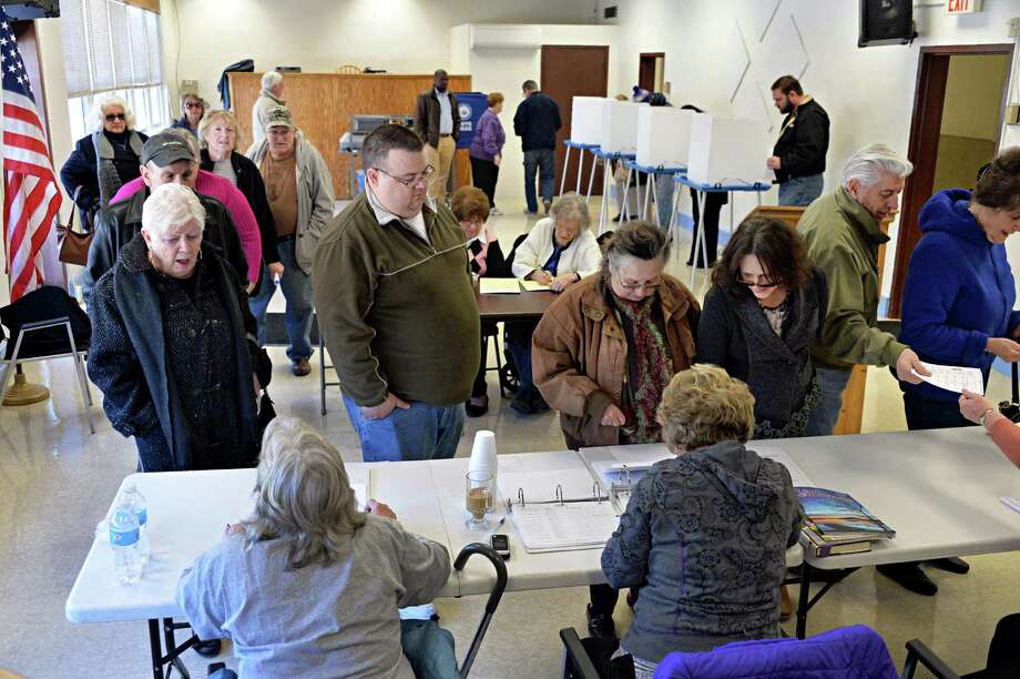 Voters crowd the Ravena Village Hall Tuesday March 18, 2014, in Ravena, NY. (John Carl D'Annibale / Times Union) Photo: John Carl D'Annibale / 00026134A