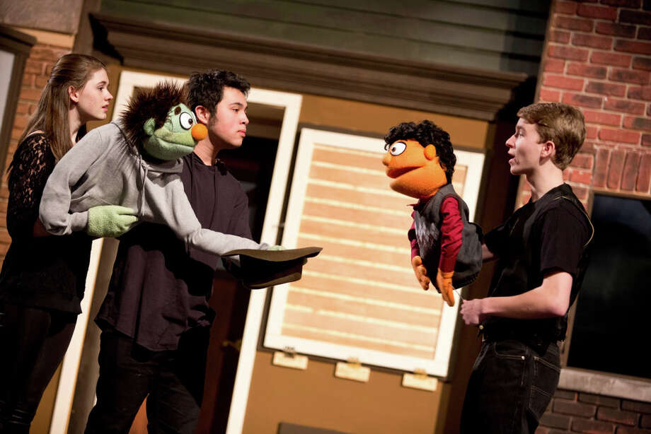 "From left, Rachel Corbally, Joe Badion and Jack Baylis rehearse a scene from the Staples Players' production of ""Avenue Q."" Performances of the Sesame Street spoof about life after college are scheduled at Staples High School March 21, 22 and 23. Photo: Westport News/Contributed Photo / Westport News"