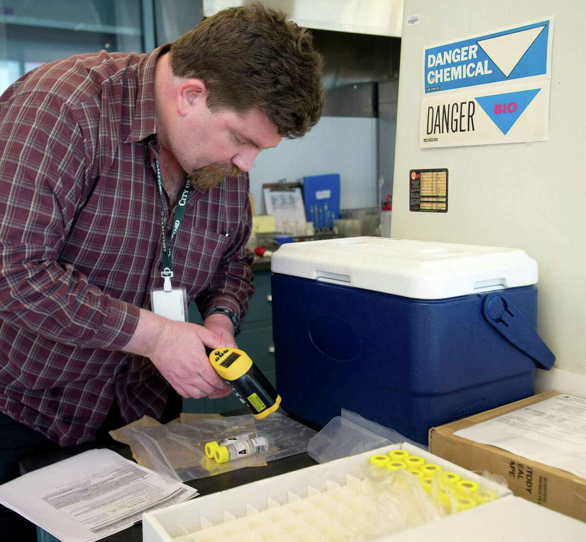Jason Glenn labels well watersamples to be tested for pesticides, arsenic and uranium at the Heath Department Laboratory at Government Center in Stamford, Conn., on Tuesday, March 18, 2014.