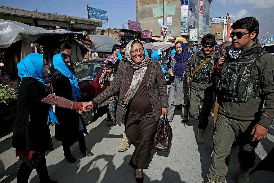 Afghan vice presidential candidate Habiba Sarabi, center, greets a supporter as she arrives at a campaign rally in Kabul. Sarabi is the most prominent woman running in the April 5 election. Photo: Massoud Hossaini, Associated Press