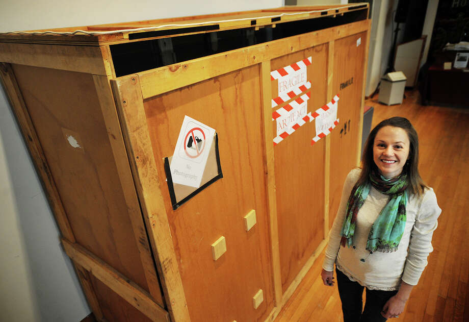 Melissa Houston, registrar for the Barnum Museum in Bridgeport, Conn. with the four by seven by 9 foot crate that the museum will unveil the contents of on April 1 at 3 pm. The unveiling event will be open to the public. Photo: Brian A. Pounds / Connecticut Post