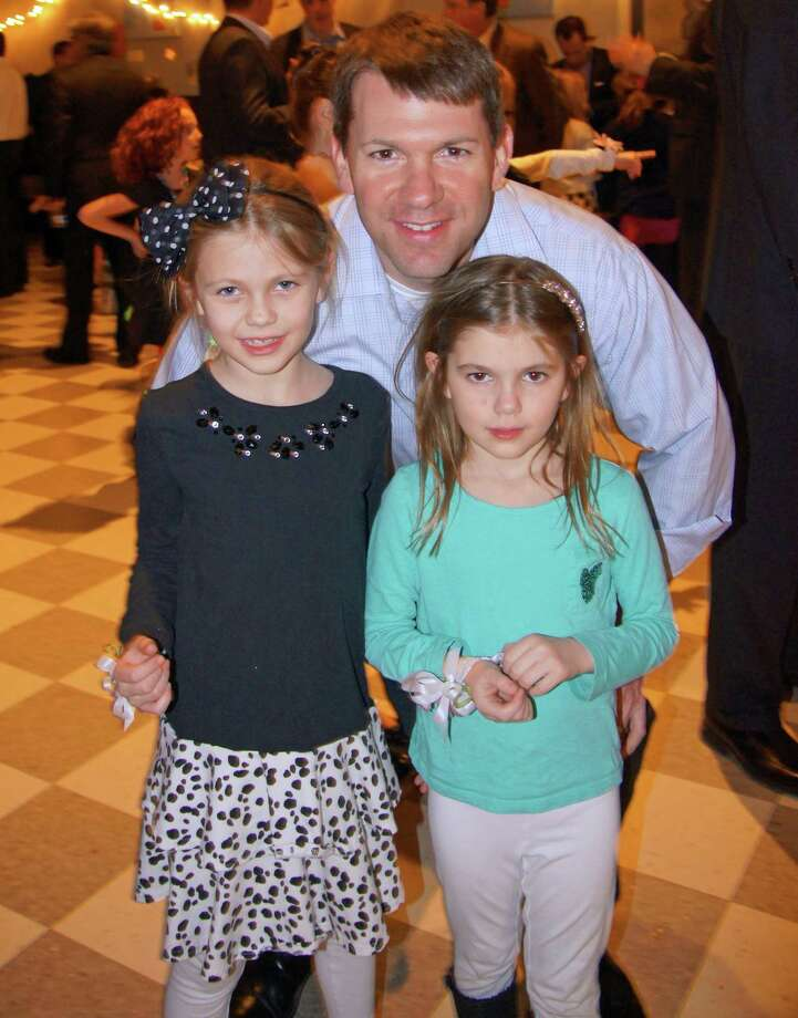 Hindley School girls and boys danced the night away with their mothers and fathers at the annual Tall and Small dances, which took place on consecutive weekends in March. Sisters Logan and Keely Fox pose with their favorite dance partner -- their father, Mark. Photo: Contributed Photo, Contributed / Darien News