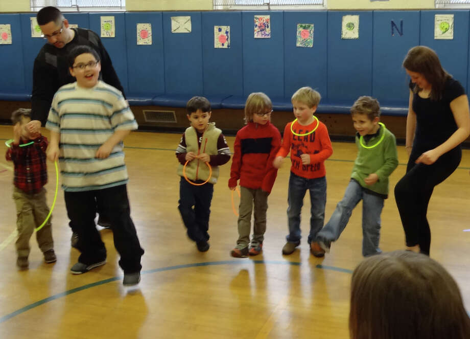 "Royle Elementary School in Darien recently rocked it out with its annual school party ""Rock n' Royle."" Students assembled to do the ""Hokey Pokey."" Photo: Contributed Photo, Contributed / Darien News"