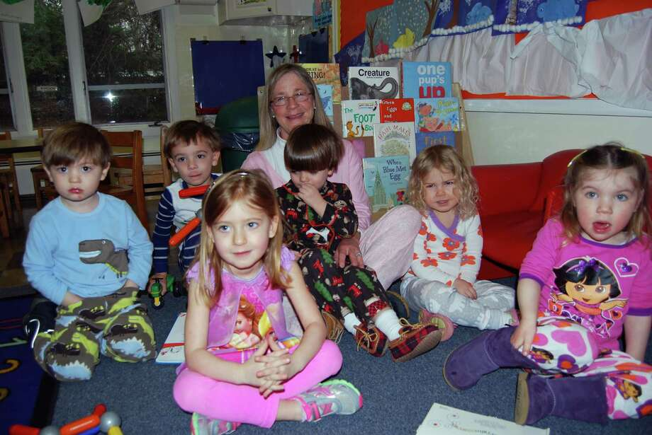 The Methodist Family Center Preschool at United Methodist Church in Darien recently hosted Pajama Day. Preschool students and their teachers dressed up in their pajamas, enjoyed pancakes and watched a movie. Theo Buchesky, Christopher Freeland, teacher Susan Wolters, Christopher Ridder, Lindsay Saiers, Clara Fiveson and Julianne Telgheder enjoy the day. Photo: Contributed Photo, Contributed / Darien News
