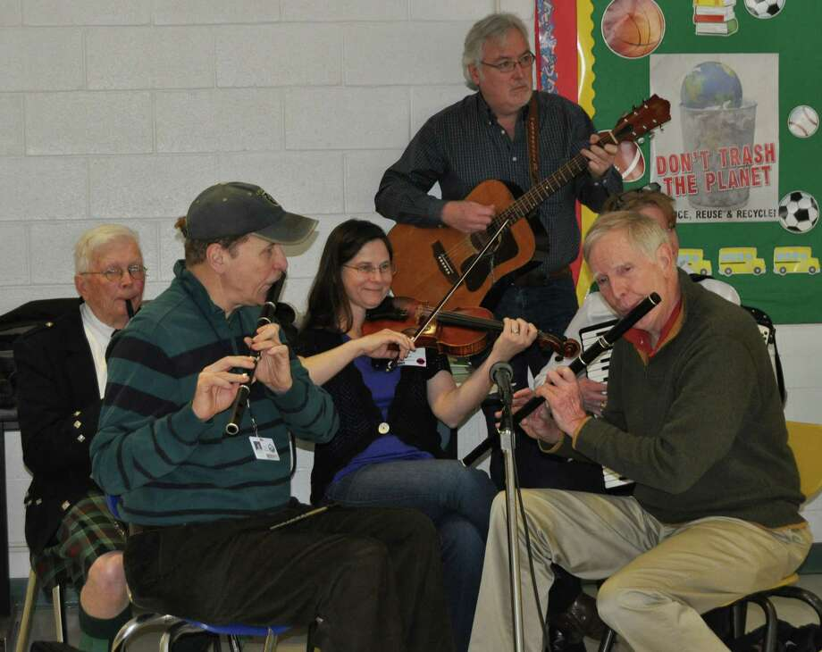 Students at Middlesex Middle School in Darien enjoyed the sound of Irish music performed by the Shamrogues during their lunch periods on the Friday before St. Patrick's Day. The Shamrogues members are, from left, Don Cavett, Bill Devlin, Lori Adams, Tim Quinn, William Morse and Monica Ferguson. Photo: Contributed Photo, Contributed / Darien News