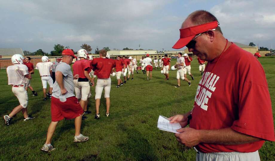 Bridge City head football coach Cris Stump looks over his practice schedule as players head for the next drills. Bridge City opens the season on Friday at home against Kirbyville.  Enterprise file photo Photo: Dave Ryan / Beaumont