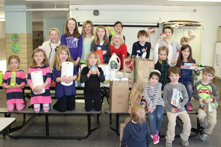 MaryJo Dyer, Amy Smith, the Kids Care Committee and the Student Council at Royle School in Darien coordinated 100 household items and 100 food items for the 100 Days of School Drive. With the help of the community, the school collected 340 household items and more than 200 food items to help neighbors in need. The Student Council and Kids Care Club joined forces to help Darien Human Services with its urgent need for common household goods as well as stocking the food pantry at Person-to-Person. Photo: Contributed Photo, Contributed / Darien News