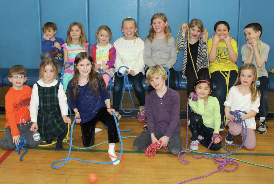 "Royle Elementary School in Darien hosted its sixth annual Jump Rope for Heart during physical education classes in the last week of February. Students obtained sponsors from family, friends and neighbors. Each class was designed with jumping activities, such as a mini trampoline, dancing, jump roping and basketball jump shots. The school's Kids Care club pledged a $1 for every minute jumped up to $100. The kids more than met the goal. A school record was set when Courtney Ball jumped 165 times on the ""tandem"" rope. Photo: Contributed Photo, Contributed / Darien News"