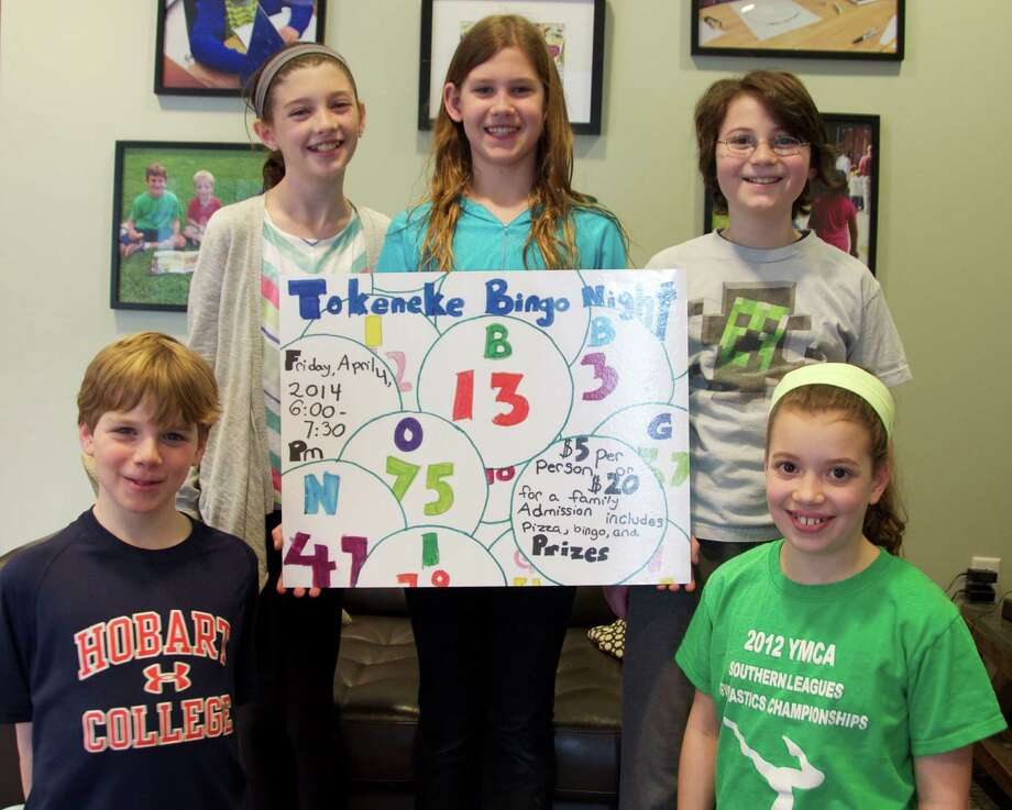 Showing off the winning Family Bingo Night poster are Tokeneke School fifth-graders. From left, Matthew Stein, Delaney Coleman, contest winner Greta Hoffmeister, Daniel Martorella and Devon Schiff. Tokeneke Schoolís annual Family Bingo Night will take place from 6 to 7:30 p.m. Friday, April 4. Photo: Contributed Photo, Contributed / Darien News
