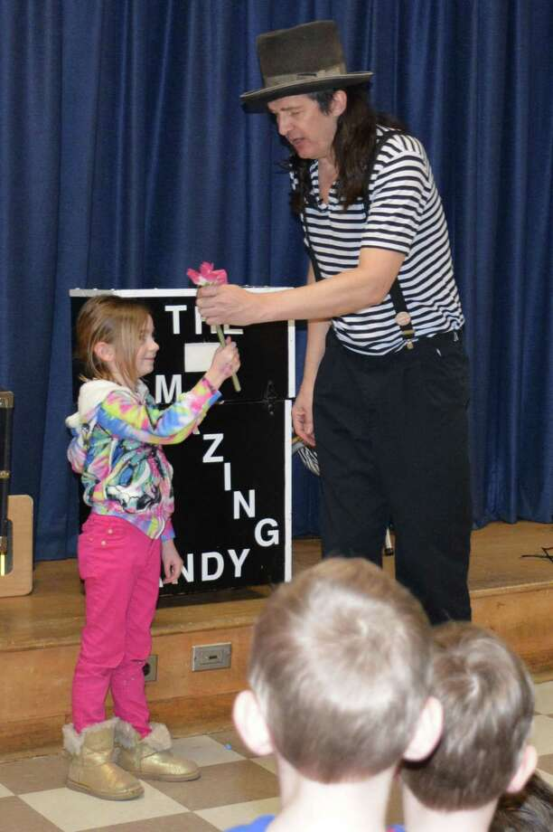Holmes School in Darien hosted its Bingo Night Feb. 28, when the magician, Amazing Andy, performed. Student Megan Niederreither had a chance to participate in his show. Photo: Contributed Photo, Contributed / Darien News