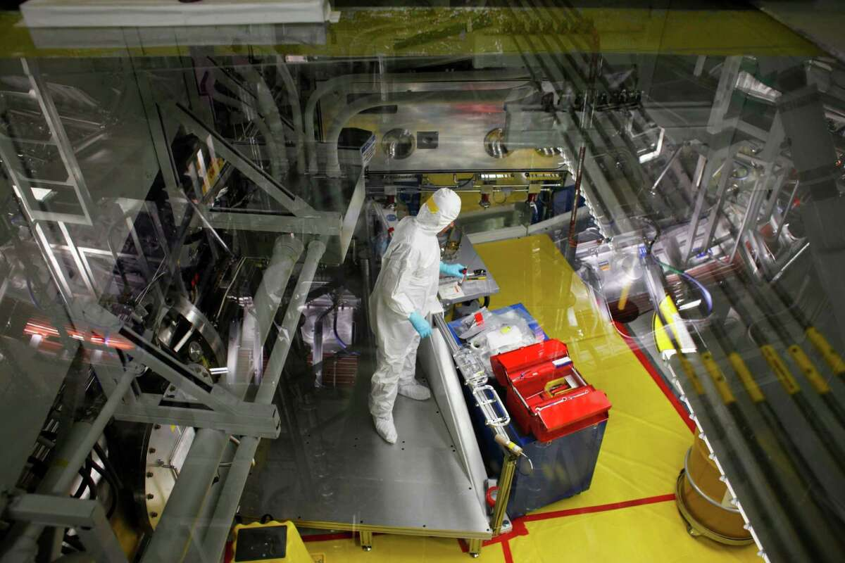 Technicians prepare a target at the National Ignition Facility at Lawrence Livermore National Laboratory on March 14, 2014 in Livermore, Calif.