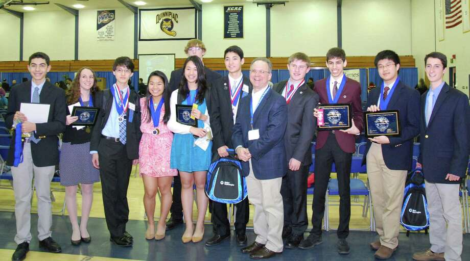 The Greenwich High School team at the Connecticut Science & Engineering fair at Quinnipiac University. From left: Kenny Dorian, Emma Goodman, Andrew Ma, Alexandra Ng, Margaret Cirino, Spencer Matonis (rear), Maxmillian Minichetti, science teacher Andrew Bramante, Peter Russell, Spencer Pevsner, Andrew Lim, and Ethan Novek. Photo: Contributed Photo / Greenwich Time Contributed