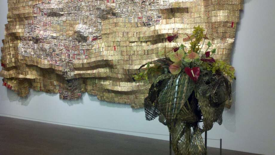 El Anatsui's 'Hover II' with Hunter-Lee Flowers' arrangement by Katsuko Thielke Photo: Leah Garchik