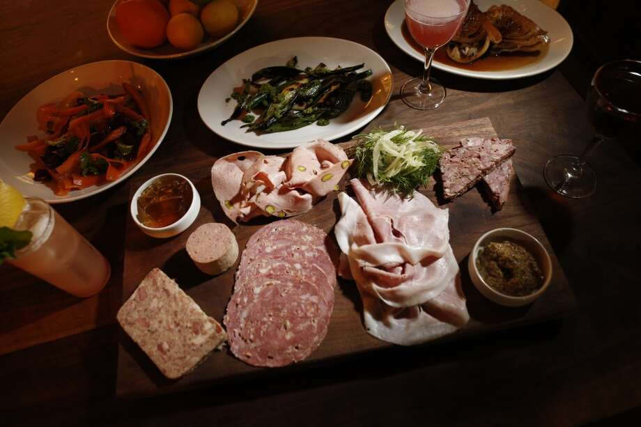 The Charcuterie Plate at Trou Normand Charcuterie plate: ciccioli, pork pate with fennel, liver sausage and mortadella. The small size serves about two, and includes your choice of four meats. $19 / $38 / $57 Photo: Carlos Avila Gonzalez, The Chronicle