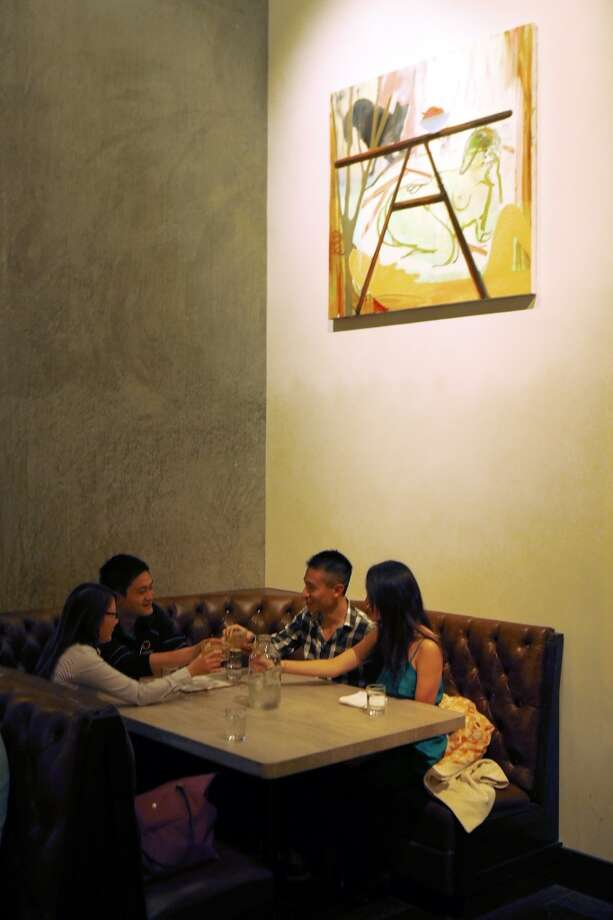 Patrons in a booth enjoy dinner at Trou Normand, the new restaurant from the Bar Agricole folks, in San Francisco. Photo: Carlos Avila Gonzalez, The Chronicle