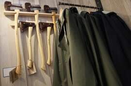 Rain jackets and axes hang side by side at Guideboat on March7, 2014 in Mill Valley, Calif.  Guideboat is a speciality store that sells wooden boats made in California as well as clothing and boating accessories.