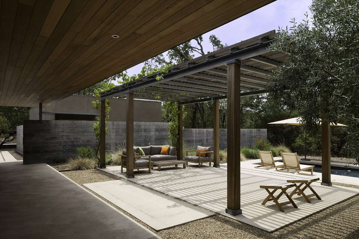The interior spaces of the home open seamlessly to the solar-heated pool, the patios and the expansive views.