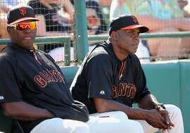 SCOTTSDALE, AZ - MARCH 15:  Barry Bonds (R) of the San Francisco Giants watches from the bench during the spring training game against the Oakland Athletics at Scottsdale Stadium on March 15, 2014 in Scottsdale, Arizona.  (Photo by Christian Petersen/Getty Images)