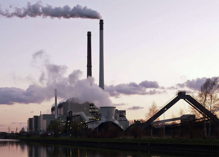 The European Union reports that by the year 2020 emissions from sectors covered by the Emissions Trading System there will be 21 percent lower than they were in 2005 and 43 percent lower by 2030. Above: A coal-fired power plant in Germany. Photo courtesy of Arnold Paul Photo: Contributed Photo, Contributed / New Canaan News Contributed