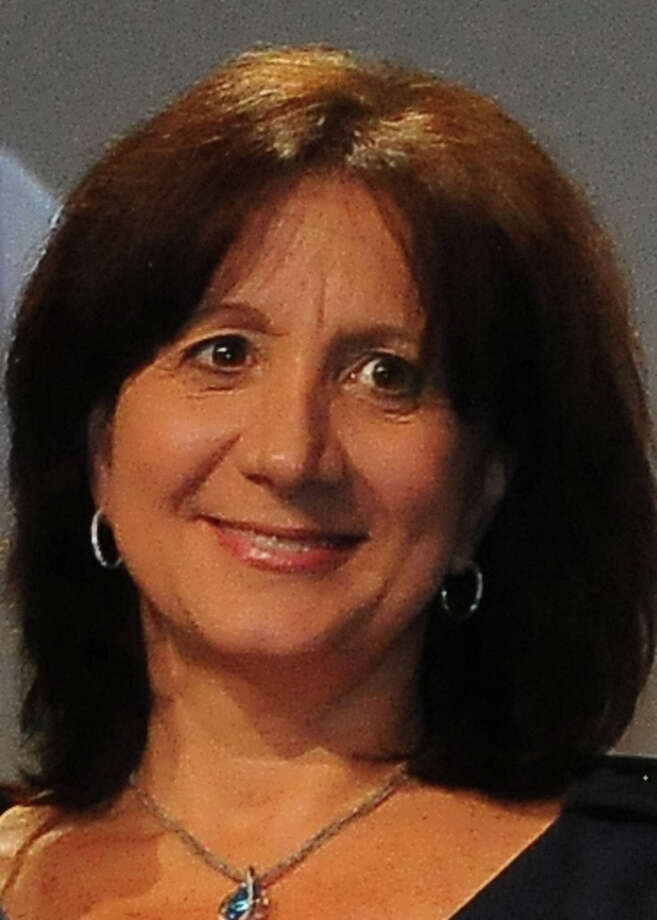 Donna Beretta, an agent in the Westport office of William Raveis Real Estate, was the top seller among the company's more than 3,000 agents in 2013. She closed on $40 million in sales lastr year, the company said. Photo: Westport News/Contributed Photo / Westport News