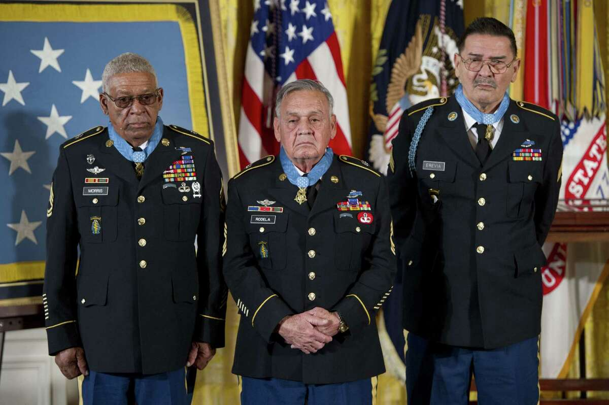 Two San Antonio veterans of the Vietnam War received the Medal of Honor during a ceremony in the East Room of the White House in Washington, Tuesday, March 18, 2014. Jose Rodela and Santiago Erevia were among two-dozen war veterans awarded the medal, the nation's highest award for valor, and just three who are still living. Read more about Rodela and Erevia. PHOTO: Medal of Honor recipients Staff Sgt. Melvin Morris (from left), Sgt. 1st Class Jose Rodela and Spc. Four Santiago Erevia stand after being awarded the Medal of Honor for actions during the Vietnam War, during a ceremony in the East Room of the White House in Washington on March 18, 2014.