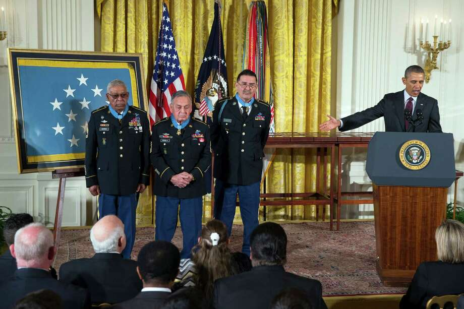 From left, Staff Sgt. Melvin Morris, Sgt. First Class Jose Rodela, and Spc. Santiago J. Erevia are applauded by President Barack Obama, right, after being awarded the Medal of Honor during a ceremony in the East Room of the White House on Tuesday, March 18, 2014, in Washington. Photo: Evan Vucci, Associated Press / AP