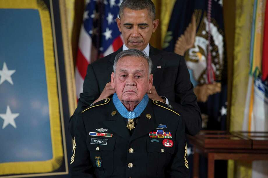 Sgt. First Class Jose Rodela is awarded the Medal of Honor by President Barack Obama during a ceremony in the East Room of the White House in Washington, Tuesday, March 18, 2014. Photo: Evan Vucci, Associated Press / AP