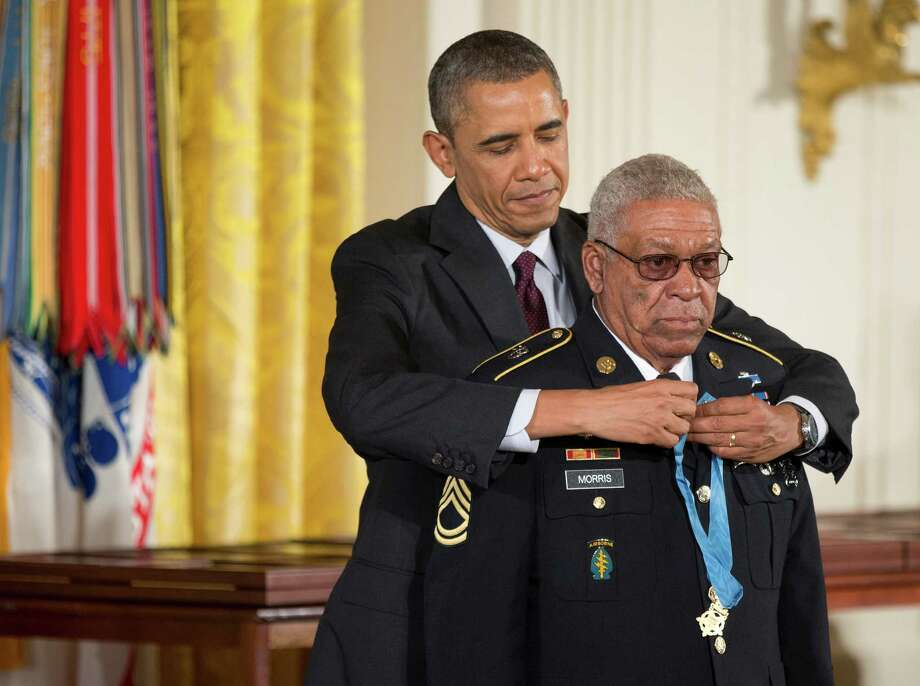 President Barack Obama awards Army Staff Sgt. Melvin Morris the Medal of Honor during a ceremony in the East Room  of the White House in Washington, Tuesday, March 18, 2014. Photo: Manuel Balce Ceneta, Associated Press / AP
