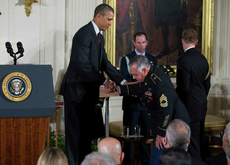 Sgt. First Class Jose Rodela is greeted by President Barack Obama before being awarded the Medal of Honor by during a ceremony in the East Room of the White House on Tuesday, March 18, 2014, in Washington. Photo: Evan Vucci, Associated Press / AP