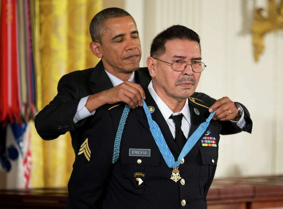 President Barack Obama awards Army Spc. Santiago Erevia the Medal of Honor during a ceremony in the East Room  of the White House in Washington, Tuesday, March 18, 2014. Photo: Manuel Balce Ceneta, Associated Press / AP