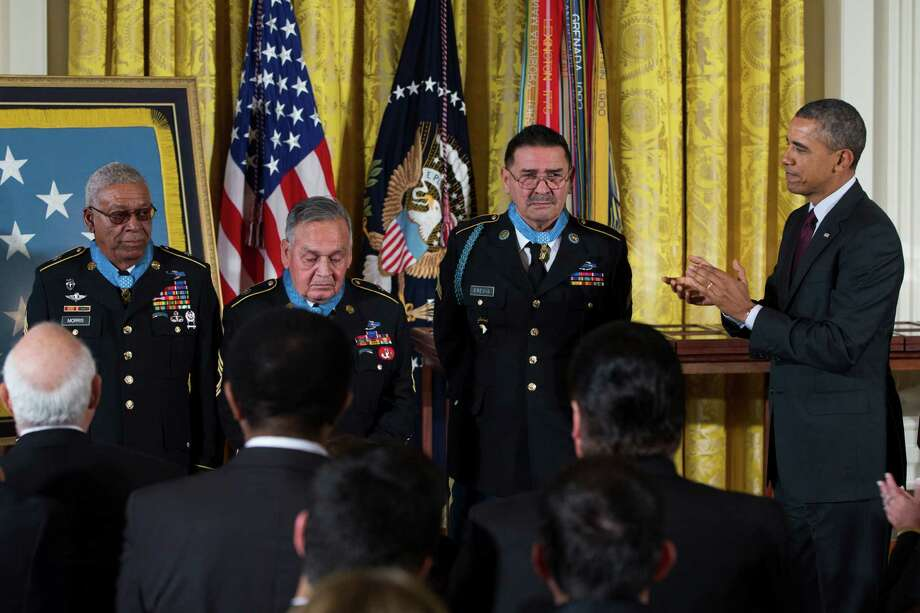 President Barack Obama applauds, from left, Staff Sgt. Melvin Morris, Sgt. 1st Class Jose Rodela, and Spc. Santiago J. Erevia after he awarded them with the Medal of Honor during a ceremony in the East Room of the White House in Washington, Tuesday, March 18, 2014. Photo: Evan Vucci, Associated Press / AP