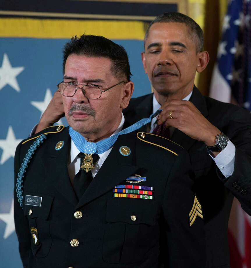 Spc. Santiago J. Erevia is awarded the Medal of Honor by President Barack Obama during a ceremony in the East Room of the White House on Tuesday, March 18, 2014, in Washington. Photo: Evan Vucci, Associated Press / AP