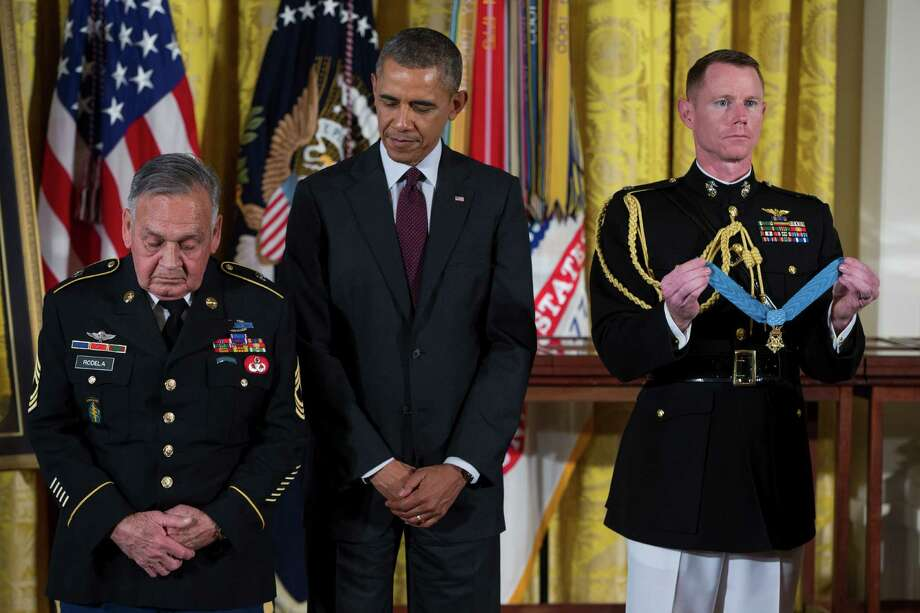 Sgt. First Class Jose Rodela stands with President Barack Obama before being awarded the Medal of Honor during a ceremony in the East Room of the White House on Tuesday, March 18, 2014, in Washington. Photo: Evan Vucci, Associated Press / AP