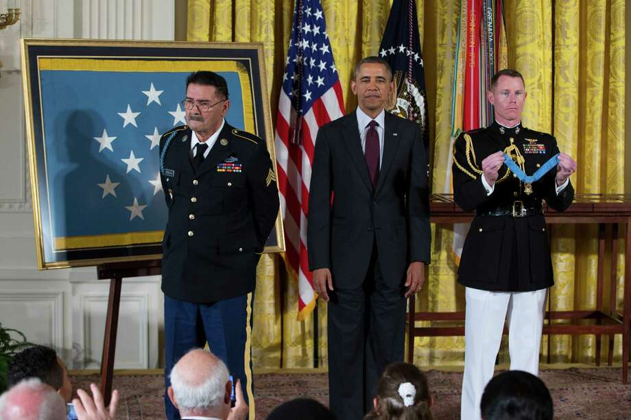 Spc. Santiago J. Erevia stands with President Barack Obama before being awarded the Medal of Honor by President Barack Obama during a ceremony in the East Room of the White House on Tuesday, March 18, 2014, in Washington. Photo: Evan Vucci, Associated Press / AP
