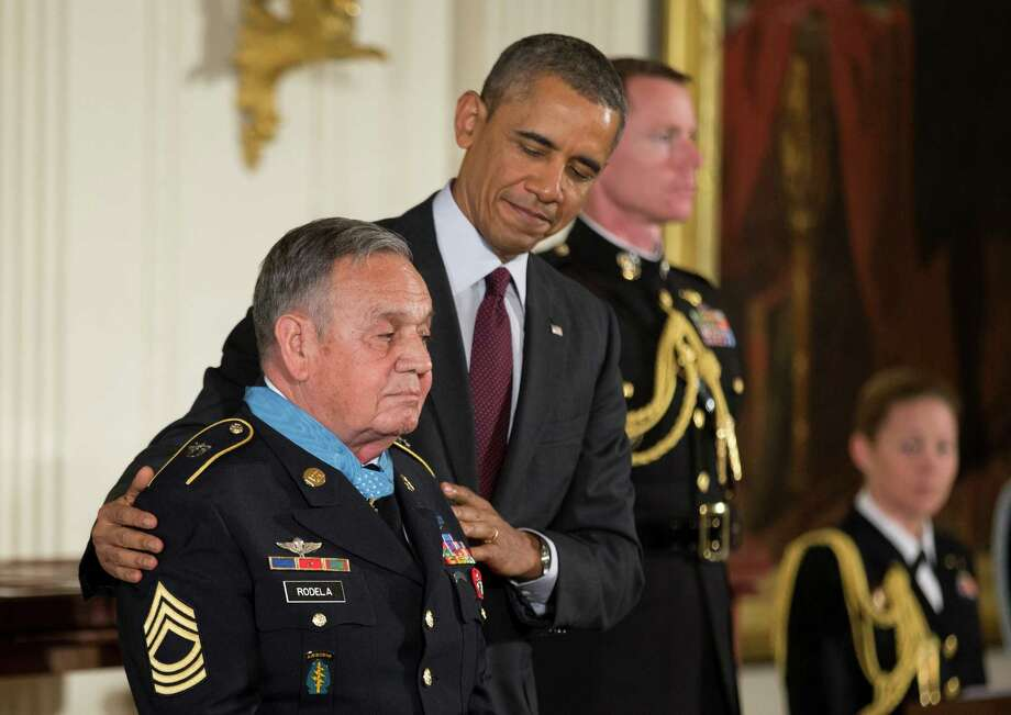 President Barack Obama looks at Army Sgt. 1st Class Jose Rodela during a ceremony in the East Room  of the White House in Washington, Tuesday, March 18, 2014, awarding Sgt. Rodela and 23 other Army soldiers, the Medal of Honor. Obama awarded the Medal of Honor to 24 ethnic or minority U.S. soldiers who performed acts of bravery under fire in three of the nation's wars, that were denied because of prejudice. Photo: Manuel Balce Ceneta, Associated Press / AP