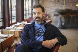 Charlie Hallowell poses for a portrait in his new restaurant, Penrose, in Oakland on November 22nd 2013.