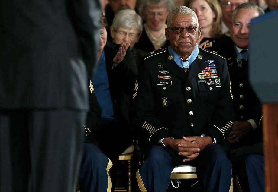 U.S. Army Staff Sgt. (Ret.) Melvin Morris listens to U.S. President Barack Obama speak at the White House after Morris was awarded the Medal of Honor on March 18, 2014 in Washington. Photo: Win McNamee, Getty Images / 2014 Getty Images