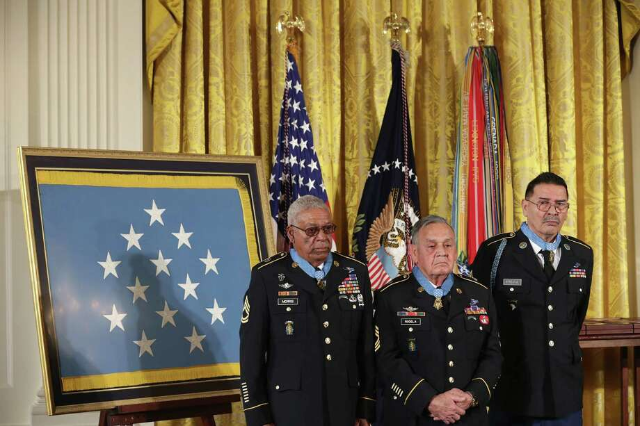 Vietnam War veterans (from left) U.S. Army Staff Sgt. (Ret.) Melvin Morris, Army Sergeant First Class (Ret.) Jose Rodela and Army Specialist Four (Ret.) Santiago Erevia are presented after receiving the Medal of Honor from President Barack Obama in the East Room of the White House on March 18, 2014 in Washington. Photo: Chip Somodevilla, Getty Images / 2014 Getty Images