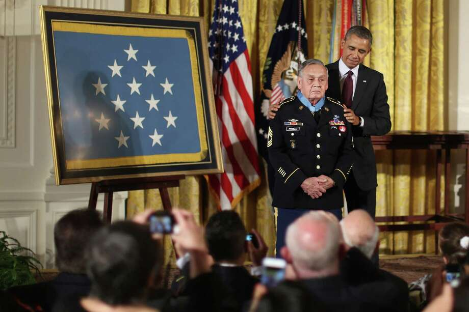 U.S. Army Sergeant First Class (Ret.) Jose Rodela, a Vietnam War veteran, receives the Medal of Honor from President Barack Obama in the East Room of the White House on March 18, 2014 in Washington. Photo: Chip Somodevilla, Getty Images / 2014 Getty Images