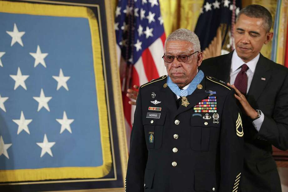 U.S. Army Staff Sgt. (Ret.) Melvin Morris, a Vietnam War veteran, receives the Medal of Honor from President Barack Obama in the East Room of the White House on March 18, 2014 in Washington. Photo: Chip Somodevilla, Getty Images / 2014 Getty Images