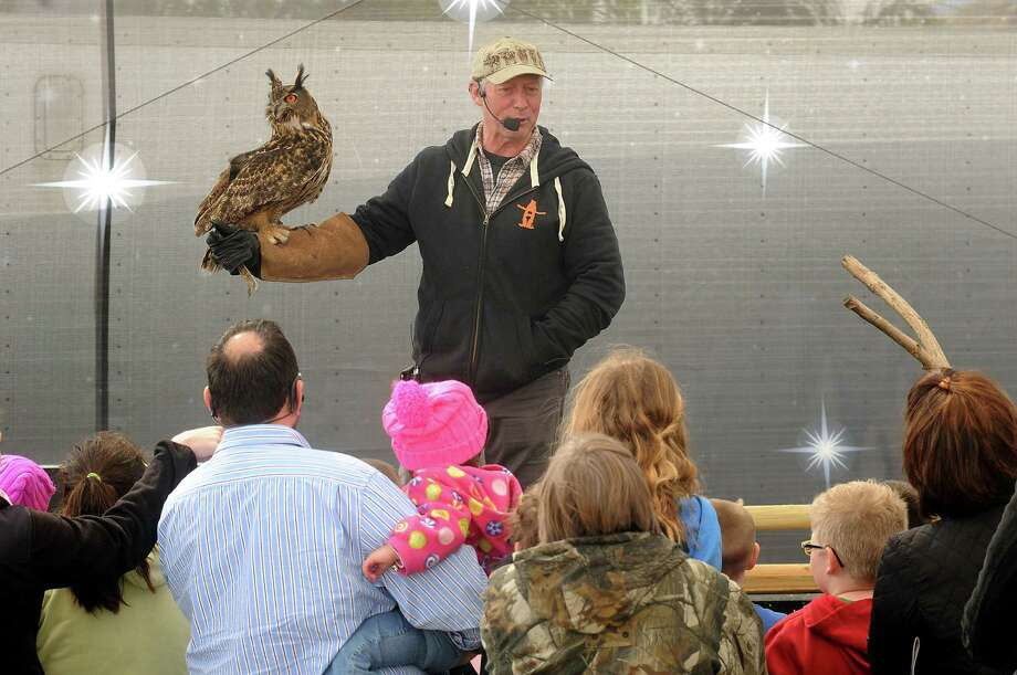 Mark Schoebel holds a Eurasian Eagle Owl during the Amazing Animals show on the Stars Over Texas Stage at the Houston Livestock Show & Rodeo Monday March 17, 2014. Photo: Dave Rossman, For The Houston Chronicle / Freelance