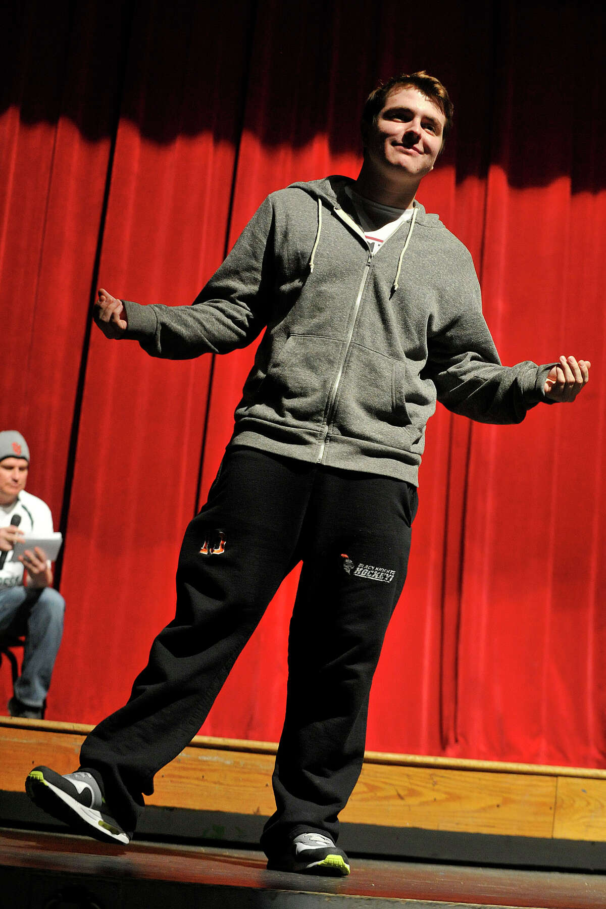 Senior Brian Powers strikes a pose during the Fashion Show fundraiser dress rehearsal at the Stamford High School auditorium in Stamford, Conn., on Tuesday, March 18, 2014. Members of the senior and junior class will show off their fashions from four local vendors on Thursday at 7 p.m. at the high school. Half of the proceeds will benefit the senior class prom after-party, which is June 6, and the other half of the proceeds go towards next year's after-prom party.