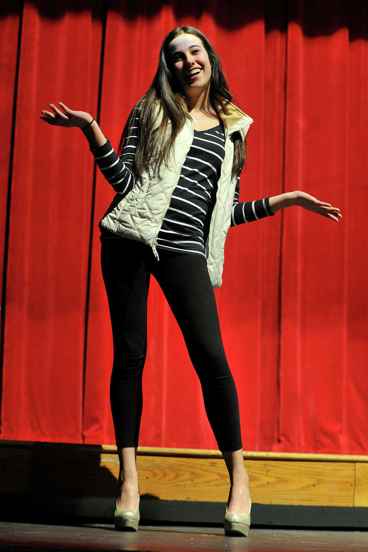 Senior Nicole May strikes a pose during the Fashion Show fundraiser dress rehearsal at the Stamford High School auditorium in Stamford, Conn., on Tuesday, March 18, 2014. Members of the senior and junior class will show off their fashions from four local vendors on Thursday at 7 p.m. at the high school. Half of the proceeds will benefit the senior class prom after-party, which is June 6, and the other half of the proceeds go towards next year's after-prom party.