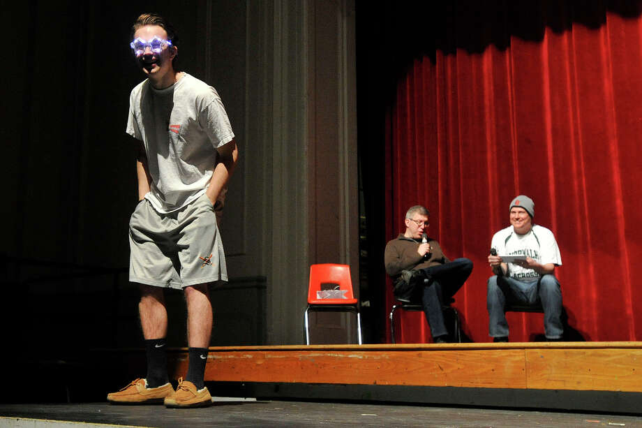 Dylan Senecal sporst a pair of lighted novelty glasses while striking a pose on stage during the Fashion Show fundraiser dress rehearsal at the Stamford High School auditorium in Stamford, Conn., on Tuesday, March 18, 2014. Members of the senior and junior class will show off their fashions from four local vendors on Thursday at 7 p.m. at the high school. Half of the proceeds will benefit the senior class prom after-party, which is June 6, and the other half of the proceeds go towards next year's after-prom party. Photo: Jason Rearick / Stamford Advocate