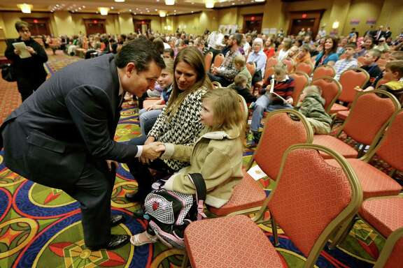 U.S. Sen. Ted Cruz talks with Bethany Davidson after speaking at the Network of Iowa Christian Home Educators' state Capitol day event in Des Moines, Iowa.
