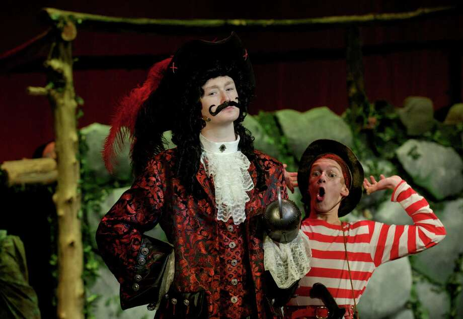 """Captain Hook, played by CJ Landgrebe , and Smee, played by Kyle Mangold, during the dress rehearsal for the Newtown High School production of """"Peter Pan' on Tuesday night, March 18, 2014. Photo: H John Voorhees III / The News-Times Freelance"""