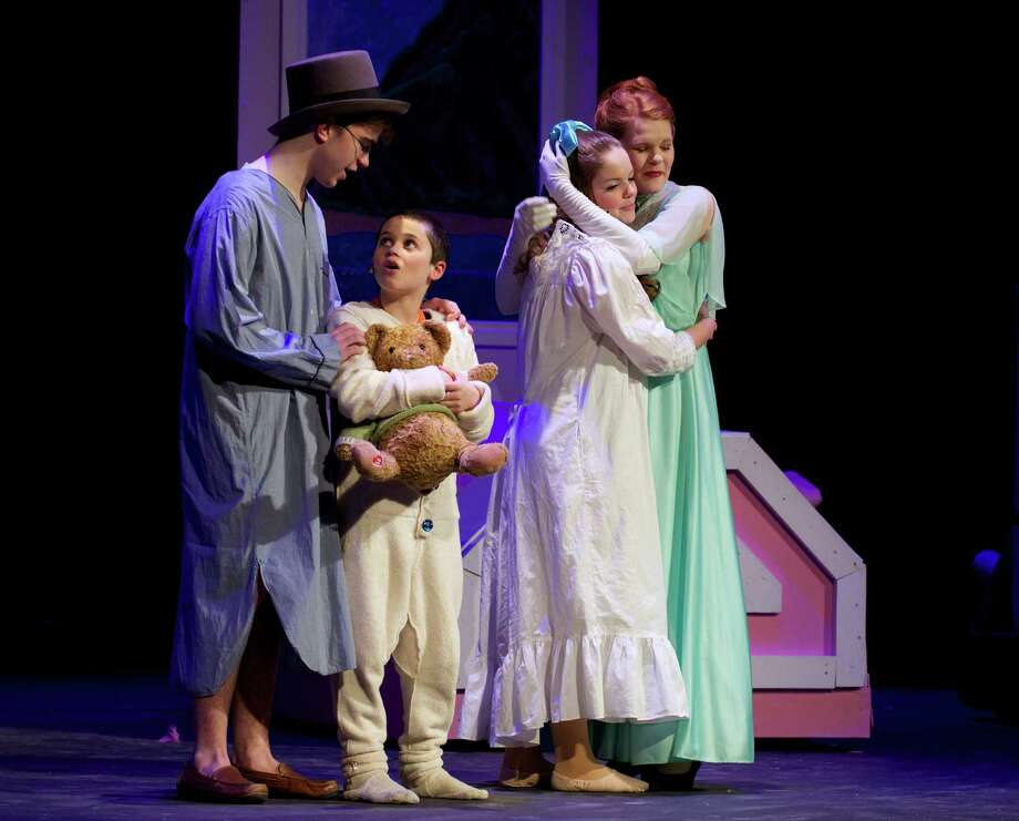 """Jeff Haylon, on left, as John, Regan Gallagher, as Michael, Lexi Tobin, as Wendy and Katie Wolff, on right, as Mrs Darling during the dress rehearsal for the Newtown High School production of """"Peter Pan' on Tuesday night, March 18, 2014. Photo: H John Voorhees III / The News-Times Freelance"""