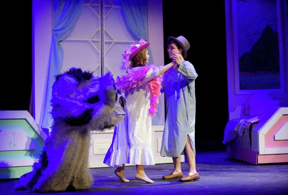 "Lexi Tobin and Jeff Haylon, playing the roles of Wendy and John, dance across the stage during the dress rehearsal for the Newtown High School production of ""Peter Pan' on Tuesday night, March 18, 2014. Playing the part of Nana the dog is Alli Lalli. Photo: H John Voorhees III / The News-Times Freelance"