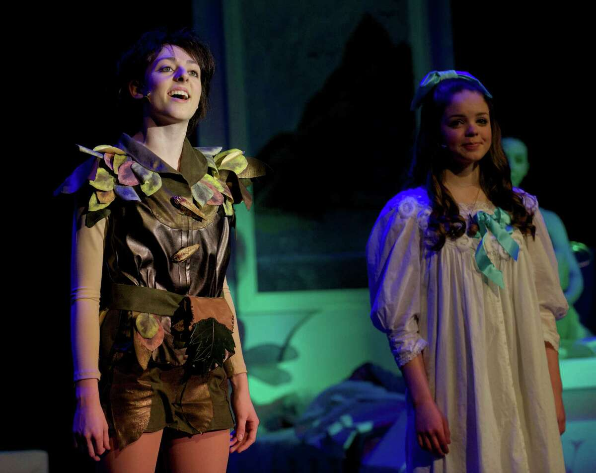 Peter Pan, played by Victoria Madden, sings to Wendy, played by Lexi Tobin, during the dress rehearsal for the Newtown High School production of